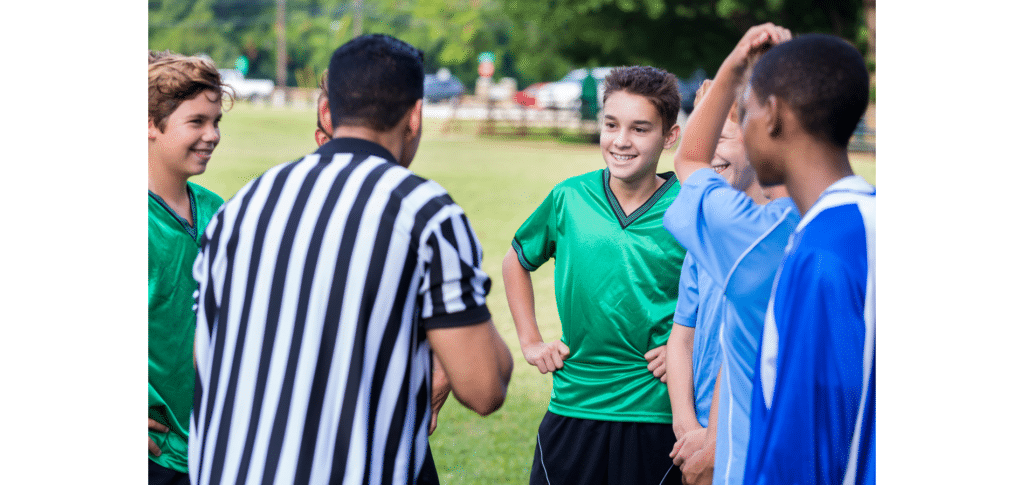 how do referees communicate in football - verbal speech